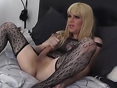 Jesse in hot black lace passionately jacks off her huge dick on the bed
