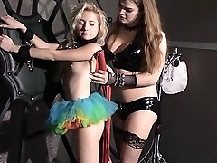 Tiffany whips a girl in dungeon