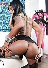 "Ebony shemale Electra loves to show off her ass and make it ""pop""."