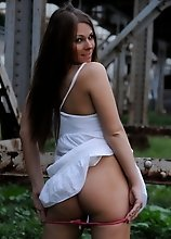 Amazing tgirl Ashley stripping outdoors